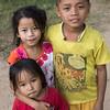 Portrait of group of three children, Ban Gnoyhai, Luang Prabang, Laos