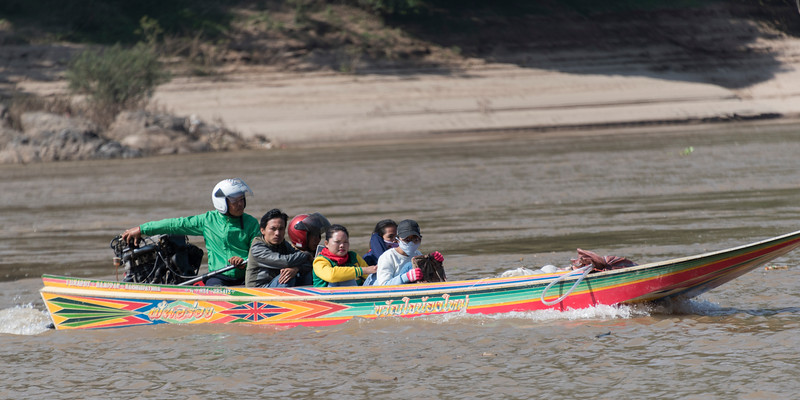 People sitting on boat in River Mekong, Laos