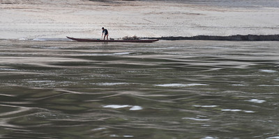 Man standing on boat in River Mekong, Sainyabuli Province, Laos