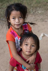 Portrait of two children standing together, Ban Gnoyhai, Luang Prabang, Laos