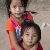 Portrait of two children standing together, Ban Gnoyhai, Luang Prabang, Laos