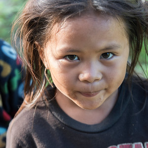 Portrait of local girl looking into camera, Luang Prabang, Laos
