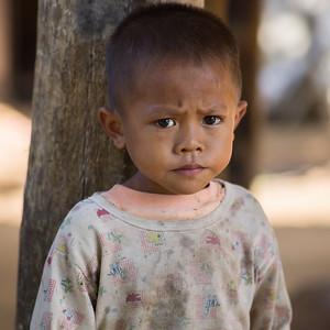 Portrait of local boy with worried expression, Ban Houy Phalam, Laos