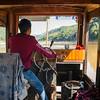 Rear view of man steering a boat, River Mekong, Luang Prabang, Laos