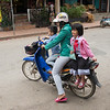 Family riding on a moped, Luang Prabang, Laos