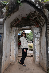 Portrait of happy woman standing in a walkway, Luang Prabang, Laos