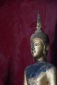 Statue in temple, Wat Xieng Thong temple, Luang Prabang, Laos