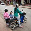 Family on moped at roadside, Luang Prabang, Laos