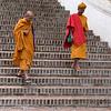 Monks moving down staircases, Luang Prabang, Laos