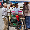 Women buying food from street vendor, Luang Prabang, Laos