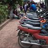 Mopeds parked on street, Luang Prabang, Laos