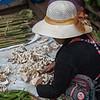 Woman sorting vegetables at street market, Luang Prabang, Laos