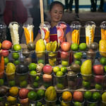 Woman selling fruit in containers, Luang Prabang, Laos