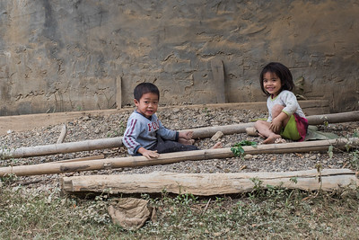 Portrait of two children playing, Luang Prabang, Laos