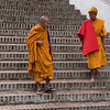 Monks moving down staircases, Luang Prabang, Laos