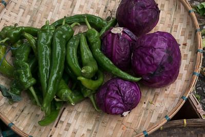 Vegetables in a basket for sale at market, Luang Prabang, Laos