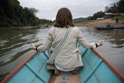 Rear View of  a Woman sitting on boat in Nam Khan river, Luang Prabang, Laos