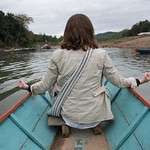 Rear View of  a Woman sitting on boat in Nam Khan river, Luang Prabang, Laos