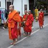 Group of monks walking on road, Luang Prabang, Laos