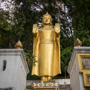 Statue of Buddha at temple, Mount Phousi, Luang Prabang, Laos