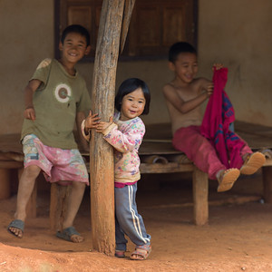 Children playing in porch, Chiang Rai, Thailand