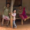 Children playing in porch, Chiang Rai, Thailand