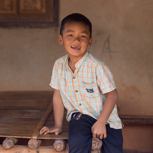 Boy smiling with his front teeth missing, Chiang Rai, Thailand