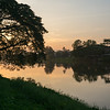 Silhouette of trees at riverside at sunset, Chiang Rai, Thailand