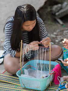 Close-up of teenage girl making craft product, Chiang Rai, Thailand
