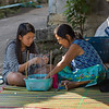 Teenage girl with a woman making craft products, Chiang Rai, Thailand