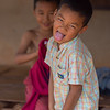 Close-up of boy sticking his tongue out, Chiang Rai, Thailand