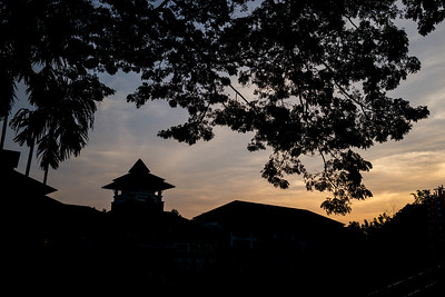 Silhouette of buildings and trees at sunset, Chiang Rai, Thailand