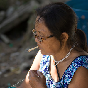 Close-up of elderly woman smoking, Chiang Rai, Thailand