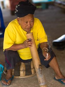 Elderly woman smoking cigarette, Chiang Rai, Thailand