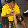 Elderly woman smoking cigarette, Chiang Rai, Thailand