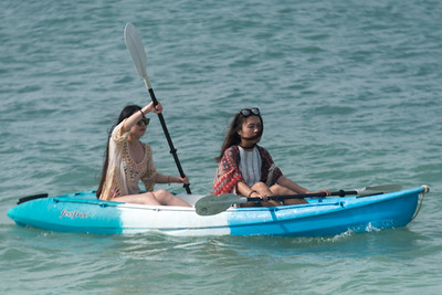 Two women kayaking in sea, Koh Samui, Surat Thani Province, Thailand