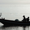 Two fishermen in boat, Koh Samui, Surat Thani Province, Thailand