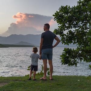 Man with his son standing on beach, Port Douglas, Queensland, Australia