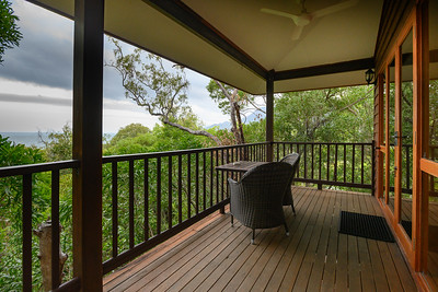 Empty table and chairs at the balcony of hotel, Port Douglas, Queensland, Australia
