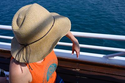 Woman sitting on boat, Port Douglas, Queensland, Australia