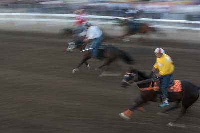 Blurred motion of jockeys riding horses at the annual Calgary Stampede, Calgary, Alberta, Canada