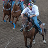 Jockeys riding horses at the annual Calgary Stampede, Calgary, Alberta, Canada