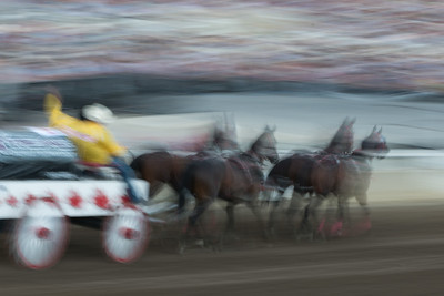 Blurred motion of chuckwagon racing at the annual Calgary Stampede, Calgary, Alberta, Canada
