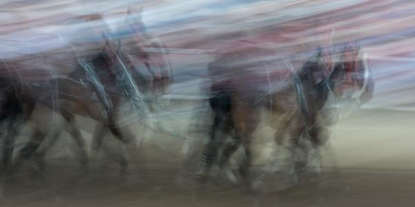 Blurred motion of chuckwagon racing at the annual Calgary Stampede, Calgary, Alberta, Canada