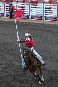 Cowgirl riding a horse at the annual Calgary Stampede, Calgary, Alberta, Canada