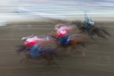 Blurred motion view of horse racing at Calgary Stampede, Calgary, Alberta, Canada