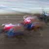 Blurred motion view of horse racing at Calgary Stampede, Calgary, Alberta, Canada