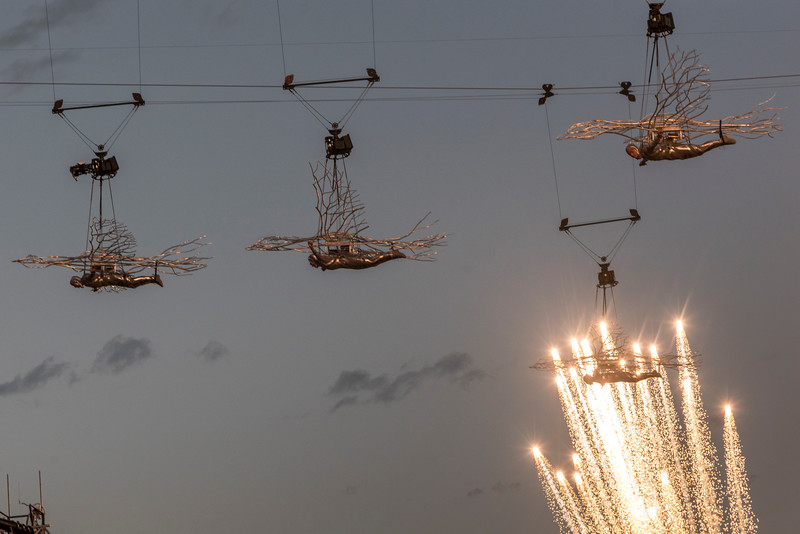 Low angle view of artists performing at Calgary Stampede with firework display in the background, Calgary, Alberta, Canada