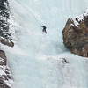 Ice climber on frozen waterfall, Lake Louise, Banff National Park, Alberta, Canada