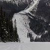 Tourist skiing in snow covered valley, Yoho National Park, British Columbia, Canada